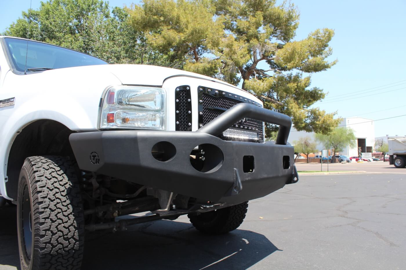 19A/19B. As you can see from these before and after shots, the finished product completely transforms the look of the truck. The Royalty Core grille and TrailReady bumper make a great pair and give the nose of the truck a strong, aggressive look. And the modifications are functional—the heavy-duty bumper won't succumb to parking lot dings, and the grille turns night into day. Not bad for about four hours of work!