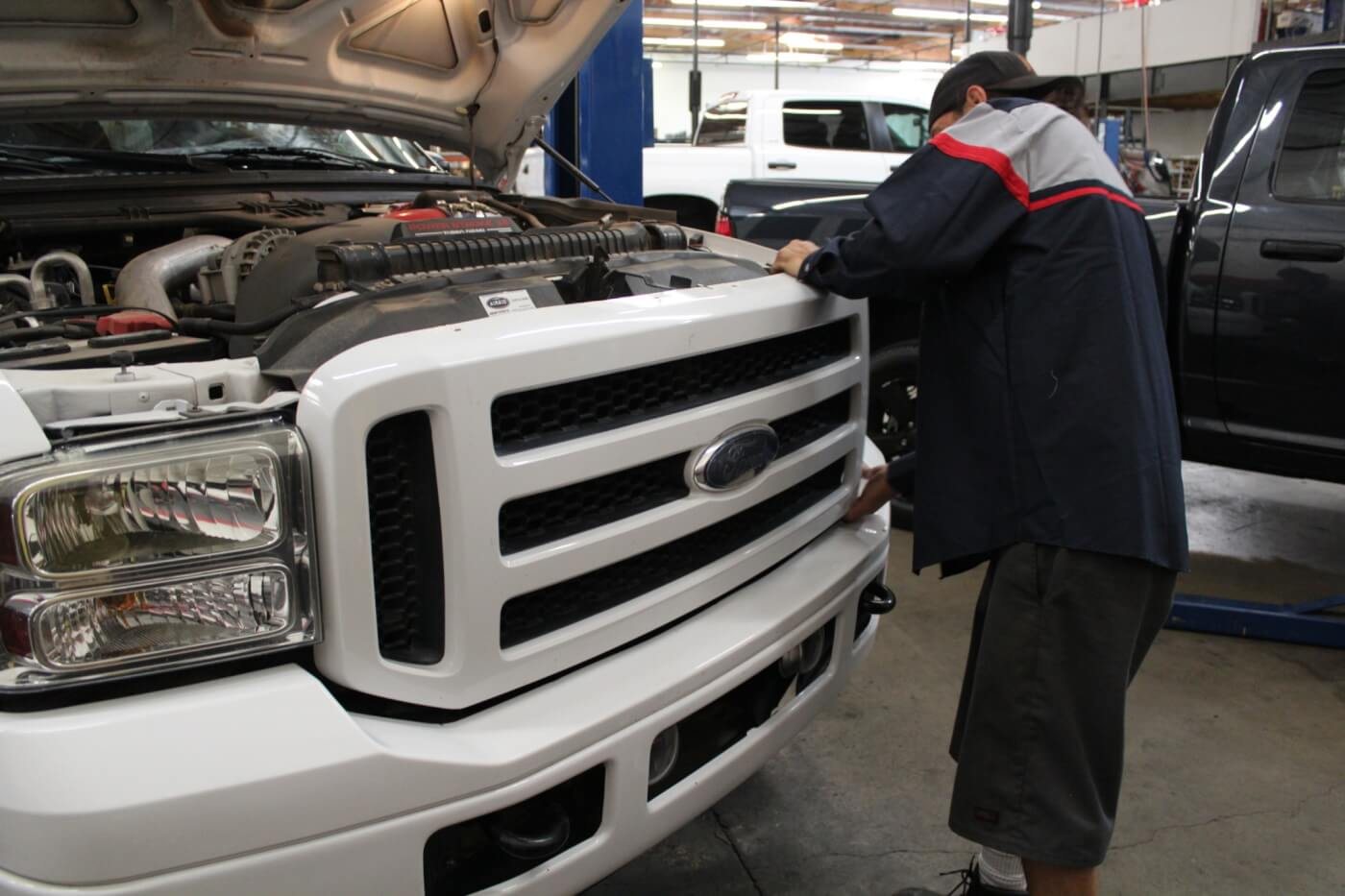 2. Just like last month's bumper installation, Brett Corder of 4Wheel Parts Wholesaler is fitting the grille to our F-250. He starts by unbolting the stock grille, which is held in place with four small bolts along the top and retaining clips along the bottom. The grille must be removed with care, as the shell will be re-used.