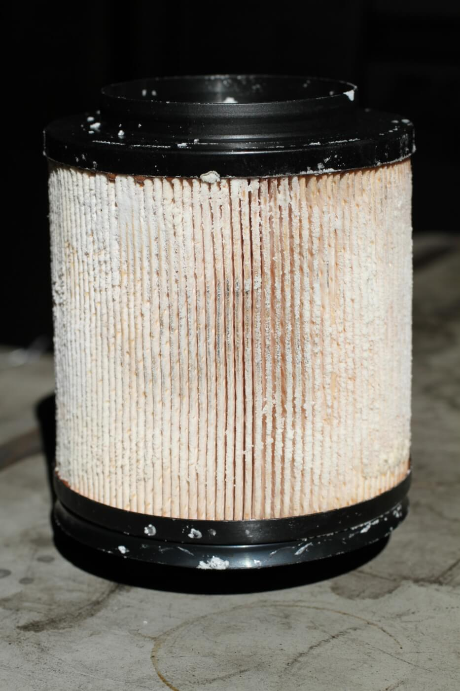 10. Here you see a fuel filter that's encrusted with urea crystals from DEF. This is a sure sign of DEF contamination in the fuel.