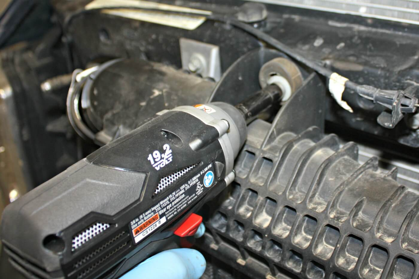 3. The intercooler is held in place by two bolts that attach it to the radiator core support.