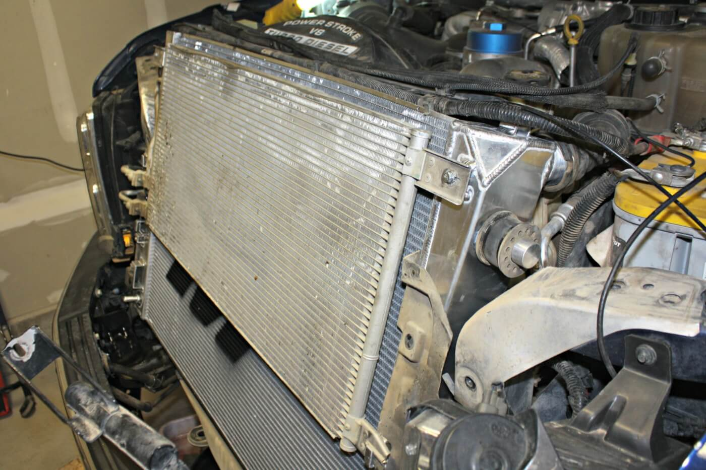 16. With the help of a friend the new radiator can be installed in the truck; reassembly is the reverse of disassembly.