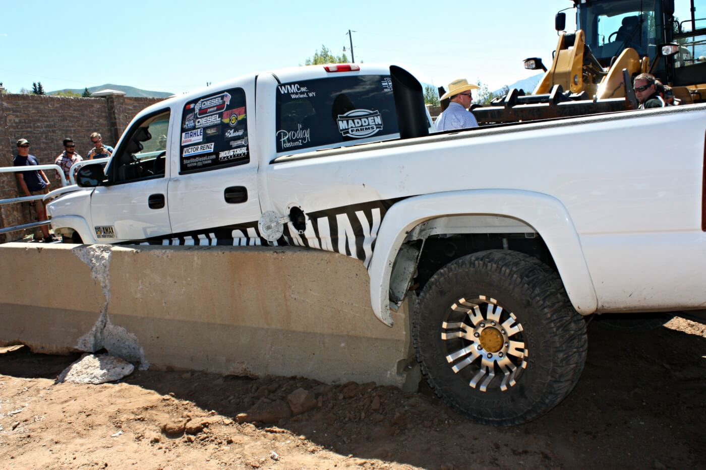 "An impromptu Dirt Drag race put together on the sled pull track mid Saturday ended early after Dan Madden's 900-hp ""Catamax"" Duramax couldn't get stopped in time and slammed into the cement barriers at the end of the track. Luckily no one was hurt."