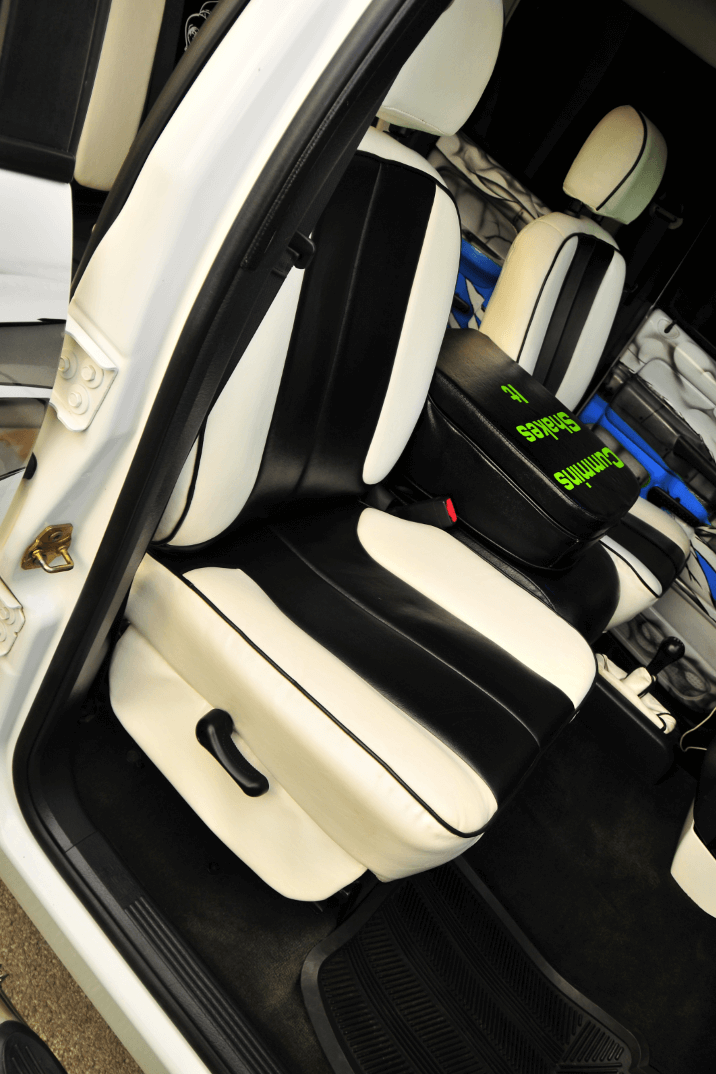 Black and white leather upholstery and a white headliner really make the inside luxurious.
