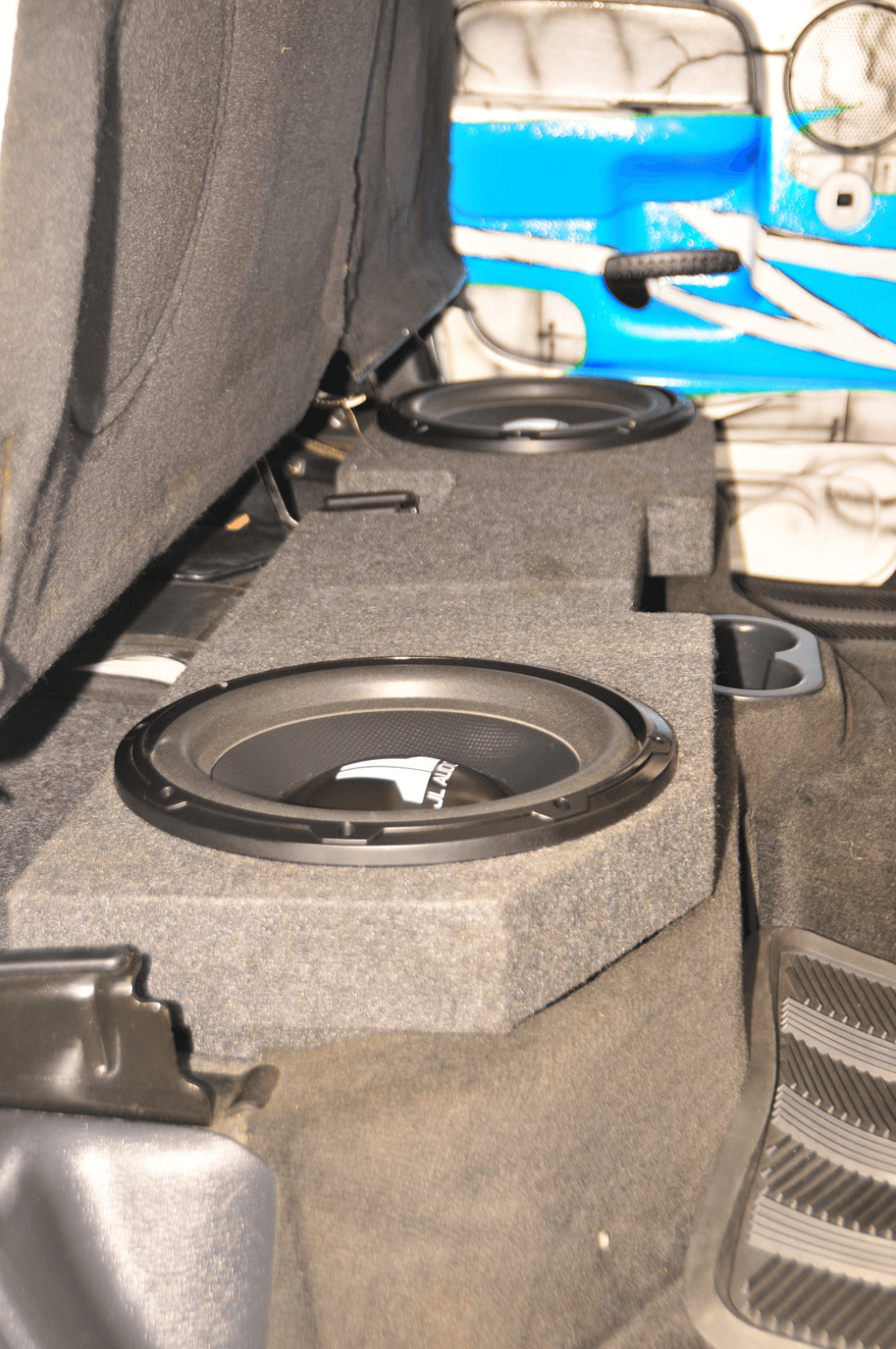 Subwoofers are located in a box under the rear seat.