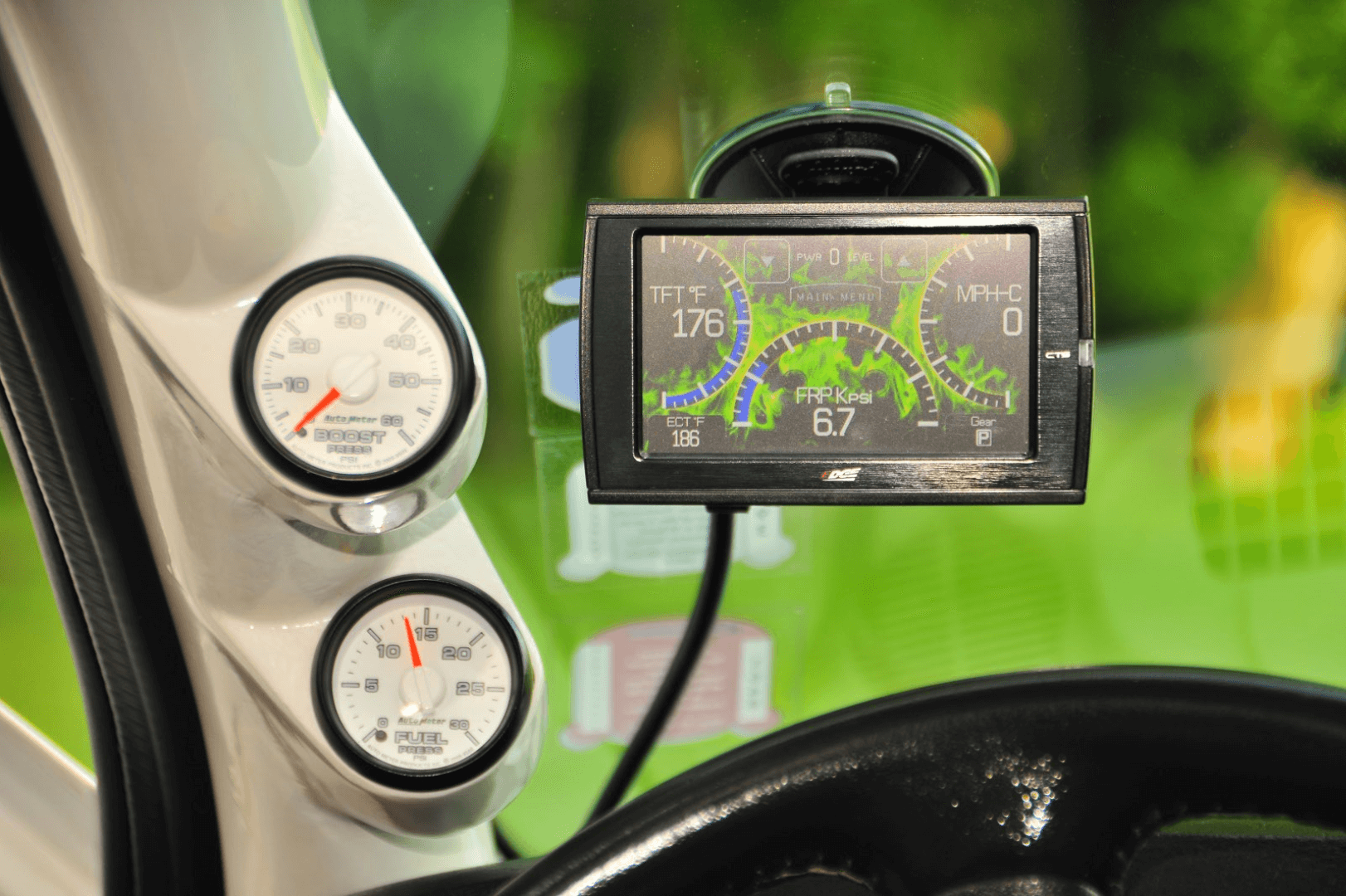 An Edge CTS monitors vital functions, as do the Auto Meter gauges on the A-pillar. A Smarty S-06 pod controls everything.