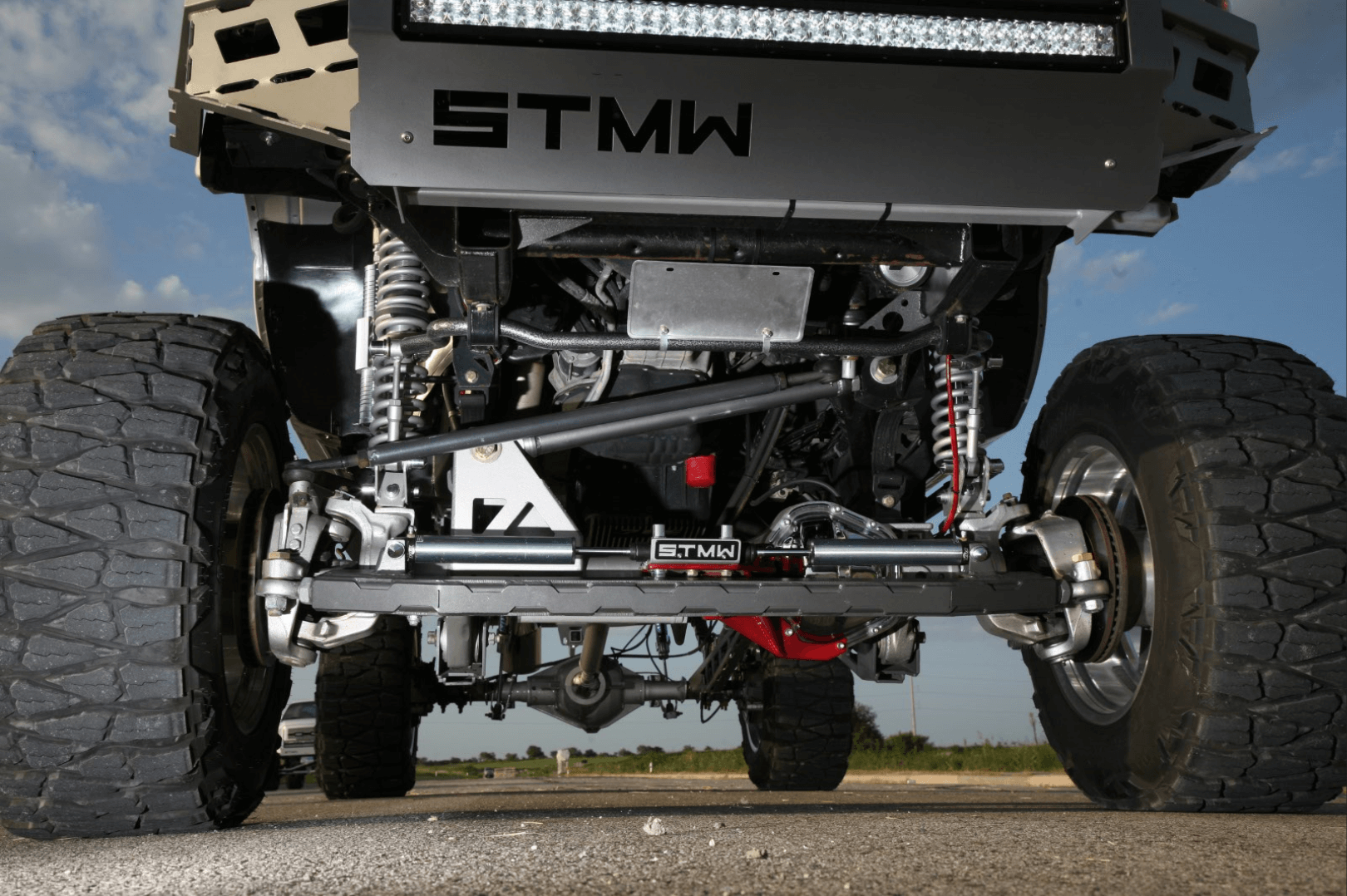 """The Naivars put a lot of work into the front suspension and steering gear to ensure the Silverado would steer accurately, even with a solid front axle and a 12-inch lift. """"I like things to work right,"""" explains brother Brandon."""