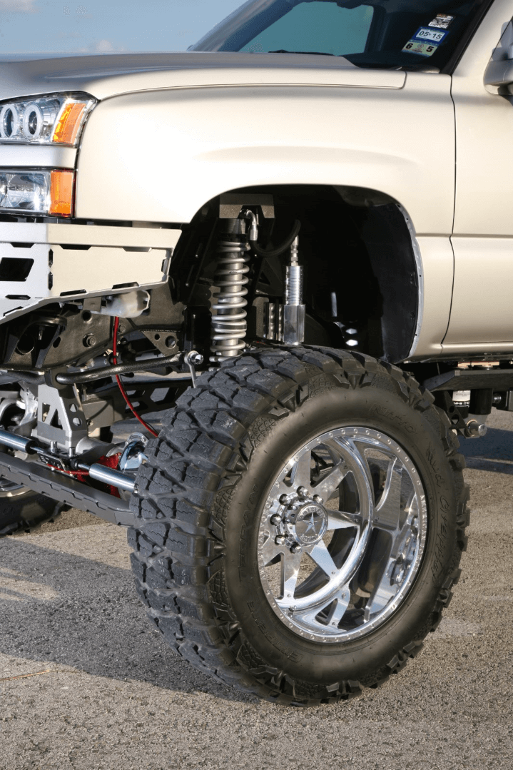 """The Chevy rides on 22"""" American Force Evade FP8 wheels with Nitto Mud Grappler tires, while 2-inch spacers give the truck its aggressive stance, and the shocks are 12-inch coilovers from Fox."""