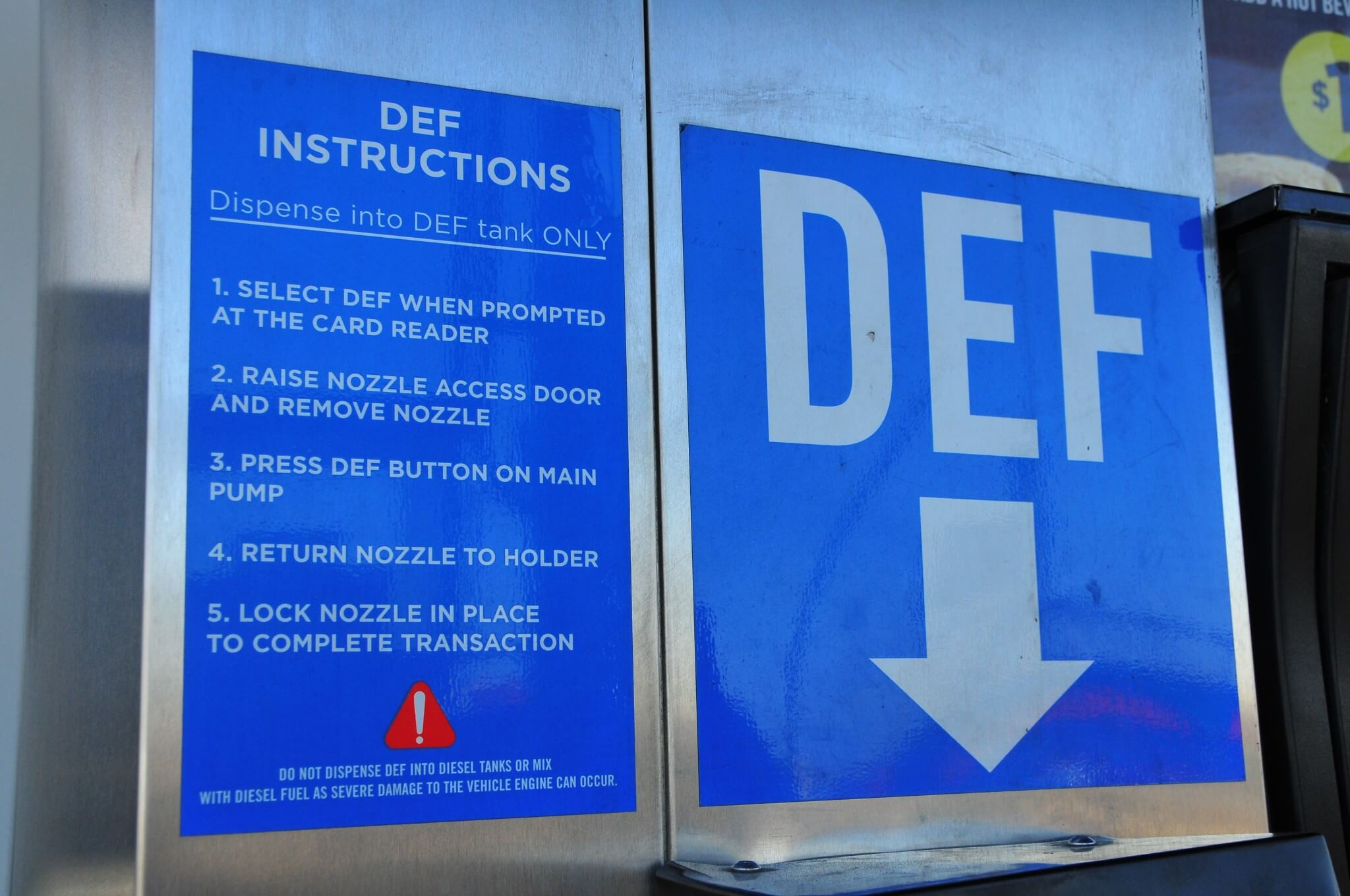 6. DEF fill stations will have a sign with instructions. The most important is seen here. In short, DEF is not to be mixed with diesel fuel. You definitely don't want to accidentally put DEF in your diesel tank. Cleaning the fuel system after this mistake is costly.