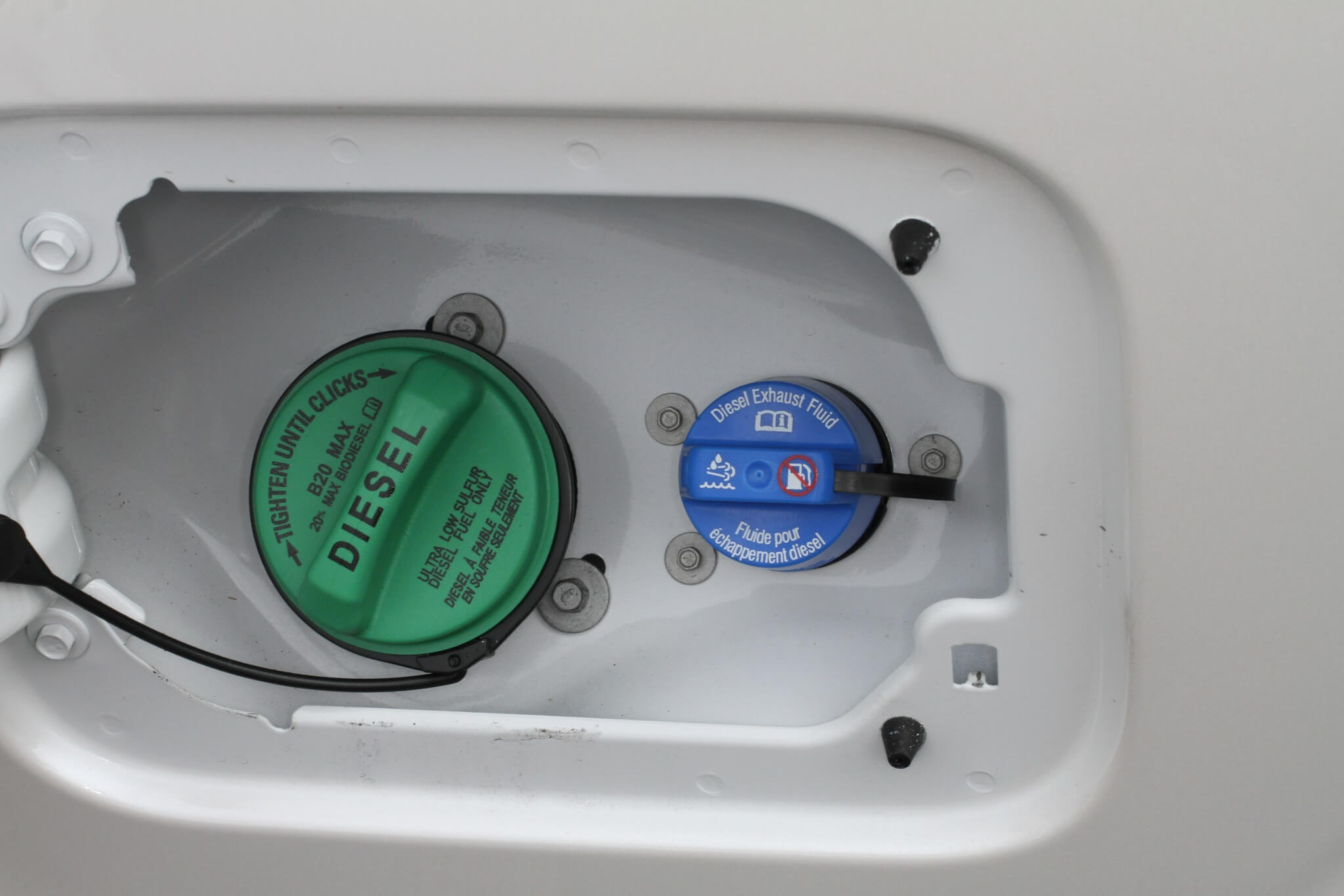 7. The DEF fill location is different between models and brands. The fuel and DEF fill are both located in the fuel door on this Ford pickup. While diesel fuel caps can vary in color, green is the most common. DEF fill caps are typically blue.